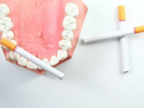 Cigarettes arranged in mock teeth