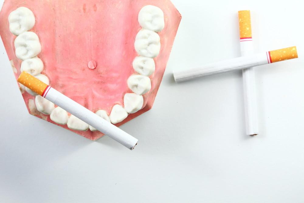 Cigarettes arranged in mock teeth
