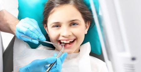 Child in the dental chair undergoing dental treatment