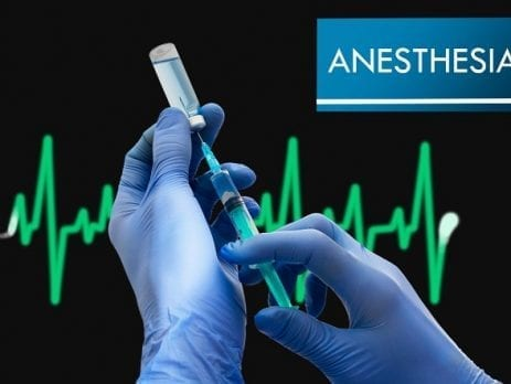Hands filling a syringe with anaesthetic